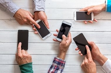 mobile phones in friends hand male